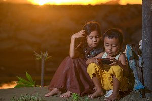Girl and boy with their smart phones