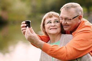 Mature couple taking selfie
