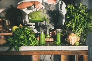 Woman pouring green smoothie from