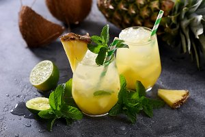 Cold pineapple cocktail with mint