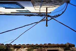 Wires against a deep blue sky.