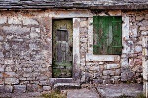 Green window and door on old traditi