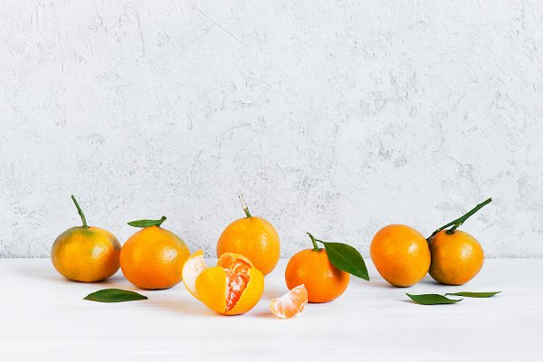 Background with fresh tangerines