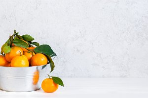 White background with tangerines