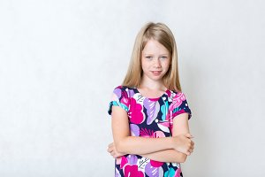 Girl standing on white background