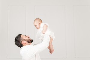 Cute baby girl with father.Studio.