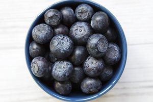 Blueberries in a blue bowl, overhead