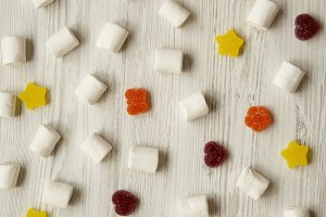 Candy on a white wooden background