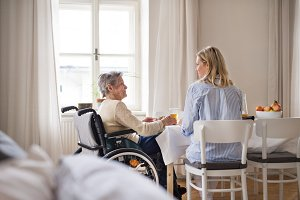 A senior woman in wheelchair with a