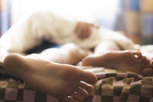 child sleep lying on the bed, close