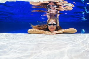 Underwater portrait of young woman