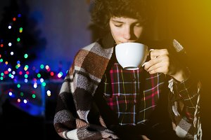 young sick teenager drinking hot tea