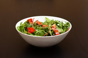 Light salad with tomatoes in white c