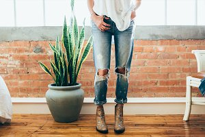 Girl, ripped jeans, star boots