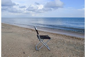 Folding chair by the sea