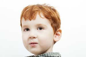 portrait of a child with red hair