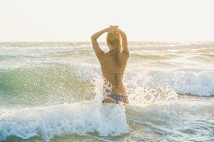 Young woman enjoying wavy waters of