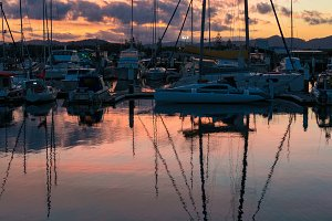 Boats in a bay with beautiful sunset