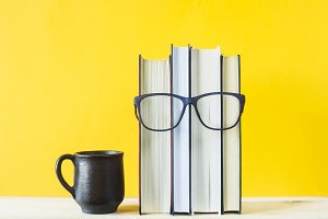 Books with glasses. Study concept