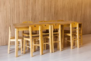 wooden table and small chairs in kin