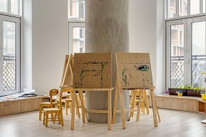 easels and wooden chairs in classroo