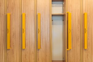 wooden lockers with yellow handles i