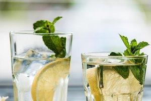 two glasses with fresh cold mojito c