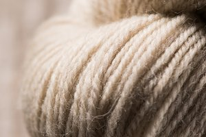 selective focus of beige knitted woo
