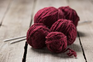 selective focus of red knitted yarn