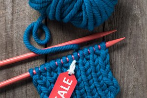 top view of blue knitting needles, b