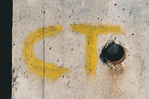 yellow ct letters on white concrete