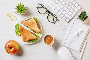 top view of workplace with sandwich,