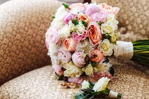 Beautiful wedding bouquet, two gold