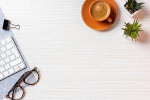top view of coffee cup, eyeglasses,