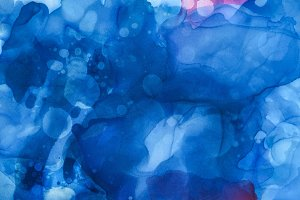 textured blue splashes of alcohol in