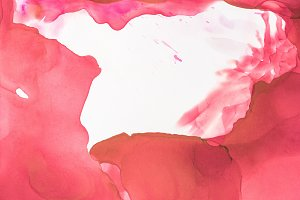 red splashes of alcohol ink on white