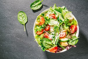 Tasty fresh salad with chicken and v