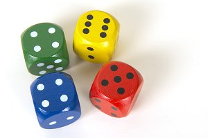 Four colorful gaming dices
