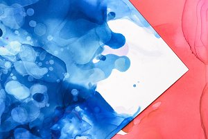 red and blue splashes of alcohol ink