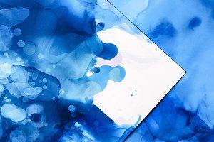 blue splashes of alcohol ink on whit