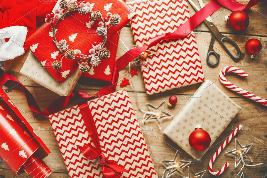 Beautiful Christmas gifts on wooden ~ Holiday Photos ~ Creative Market