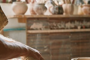cropped image of male potter working