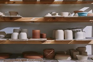 ceramic bowls and dishes on wooden s