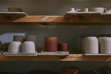 ceramic bowls and dishes on wooden s by  in Industrial