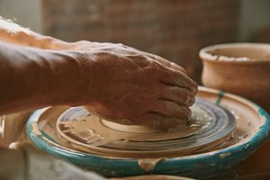 selective focus of male potter hands