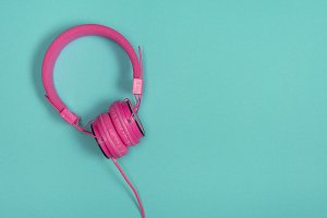 Pink headphone on a blue background
