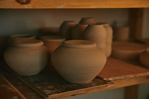 close up view of ceramic bowls and d