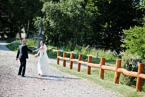 Wedding couple walking and holding h