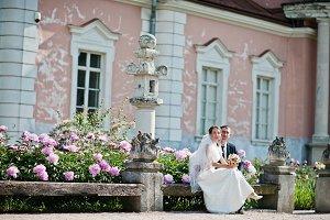 Wedding couple sitting on bench back