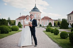 Wedding couple in the yard of castle